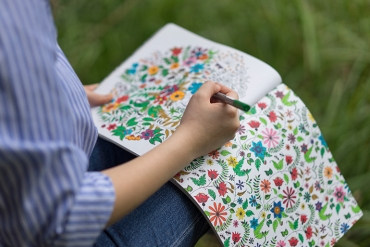adult woman colouring in a colouring book
