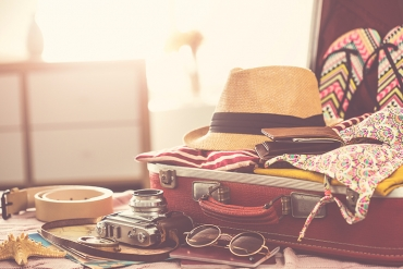 suitcase full of essential summer products
