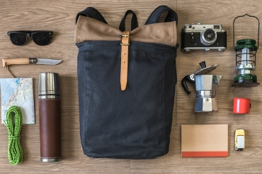 flatlay image of hiking backpack and supplies and equipment
