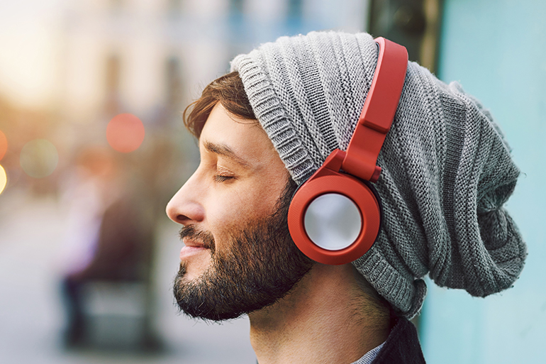 smiling man listening to music in the morning