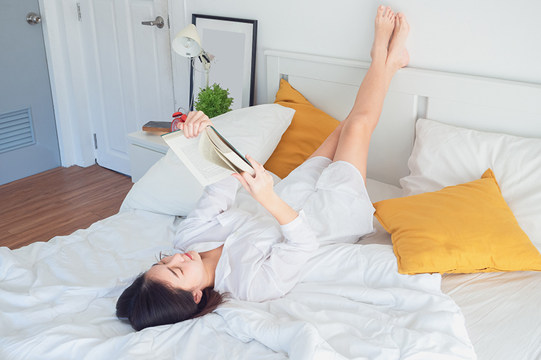 woman winding down before bed for better sleep