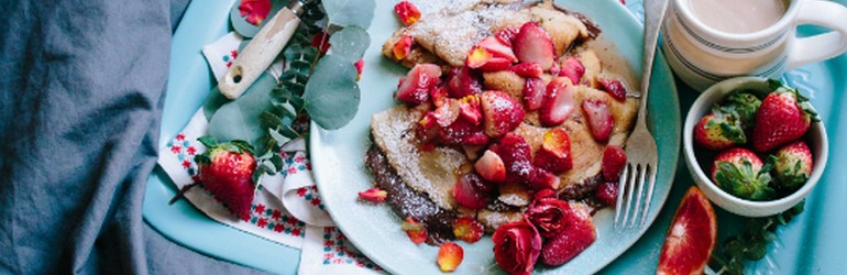 Breakfast in bed: french toast with strawberries.