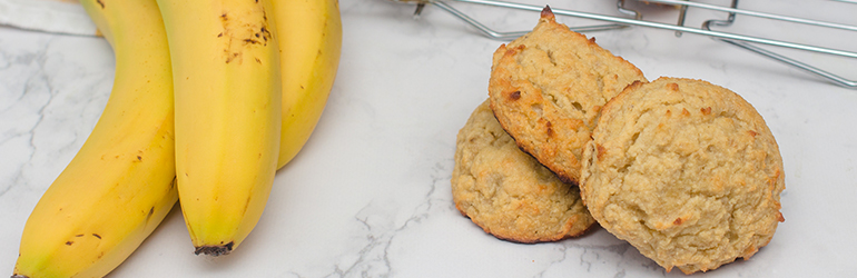 Flourless banana almond cookies with a banana next to it.