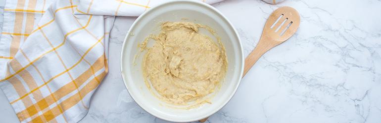 Flourless banana almond cookie dough in a bowl.