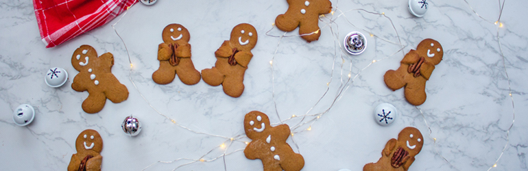 gingerbread men and women holding walnuts.
