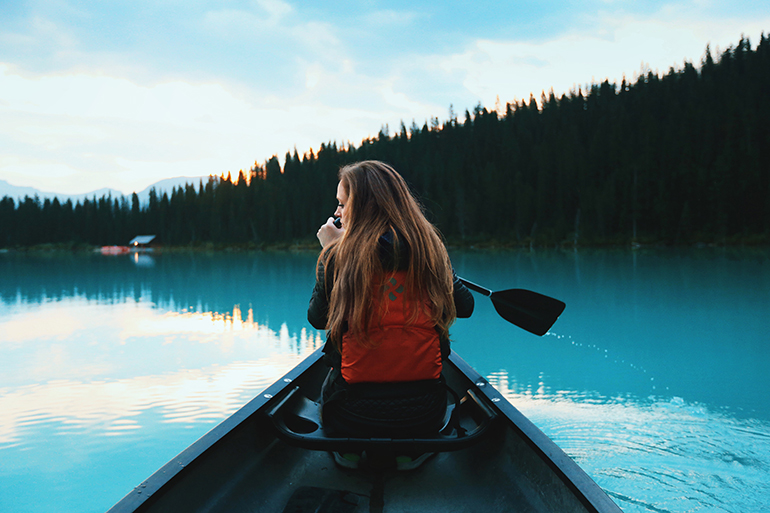 woman canoeing to connect with nature