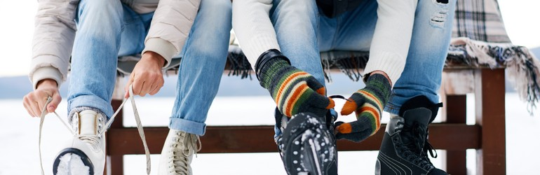 Tying up skates with family.