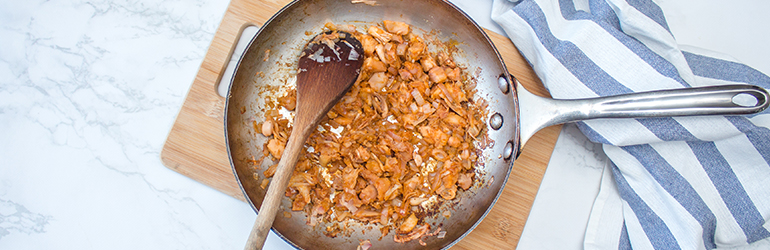Chopped up jackfruit covered in sauce.