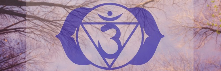 Ajna Third Eye chakra symbol in purple overlaying some trees.