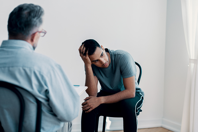 young man in therapist office