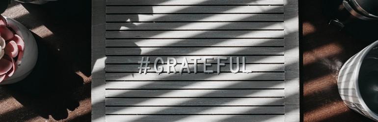 A felt board that says #gratitude on it.