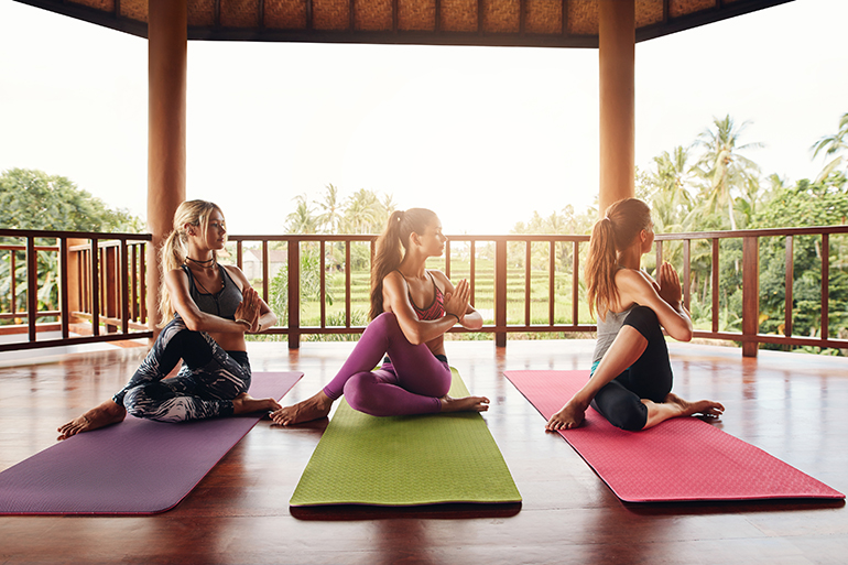 three women doing hatha yoga