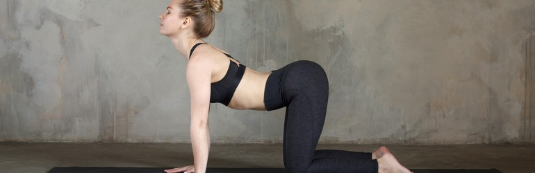 woman in cat cow yoga pose