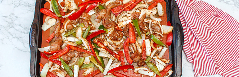 Chicken Fajitas in a sheet pan.