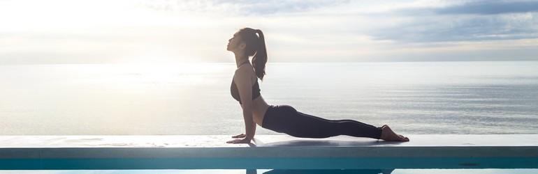 woman in cobra yoga pose