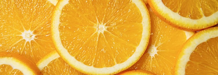 Sliced oranges fill the screen.