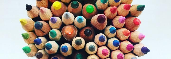 A bunch of pencil crayons in a bundle.
