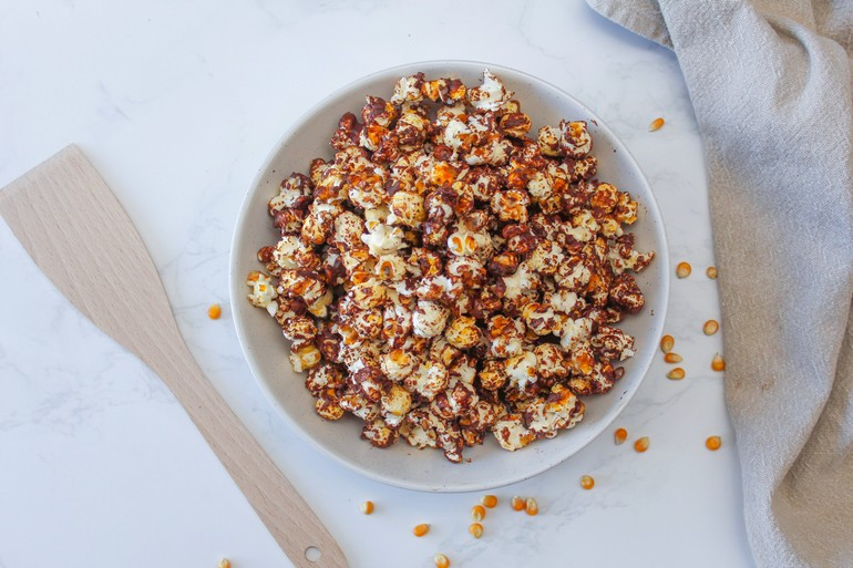 Chocolate and sea salt covered popcorn in a bowl.
