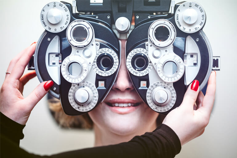 woman at eye doctors getting her eyes checked
