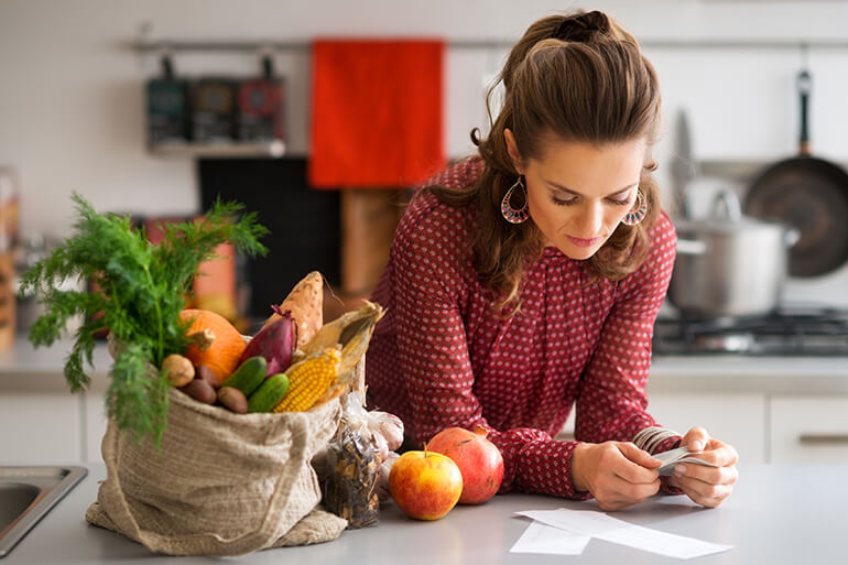 woman making budget for healthy food