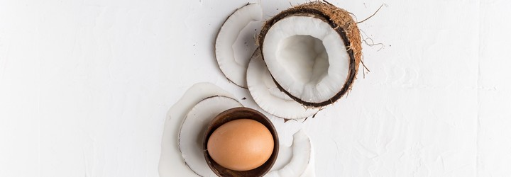 A coconut and an egg - this is representing the coconut oil and egg hair mask.