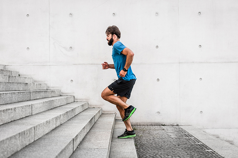 man running up stairs for healthy habits