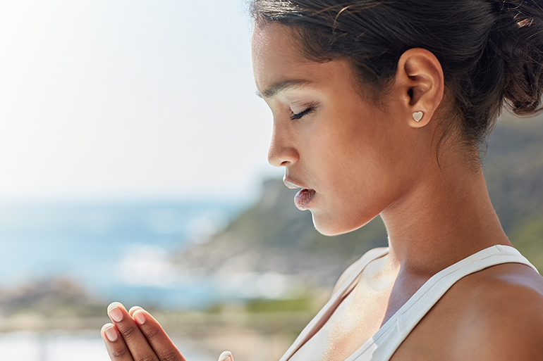 woman meditating and deep breathing