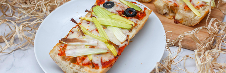Mummy pizza on a plate.