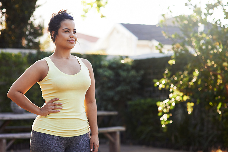 happy curvy woman looking confident while on a jog