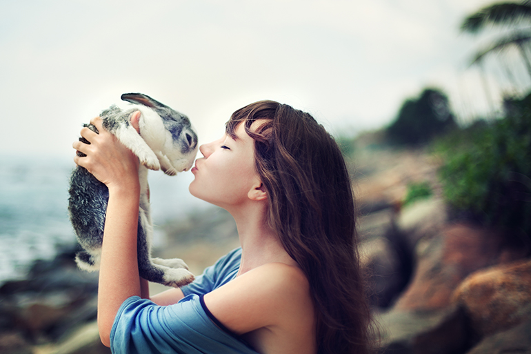 woman holding rabbit for pet therapy