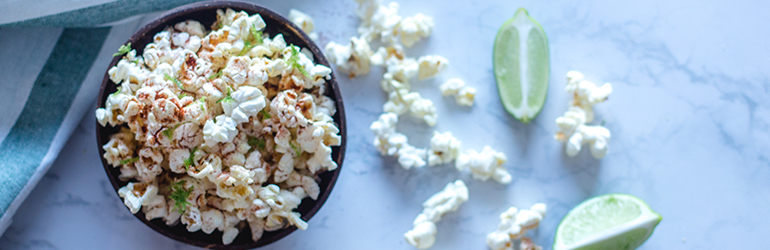 Lime and chili popcorn in a bowl.