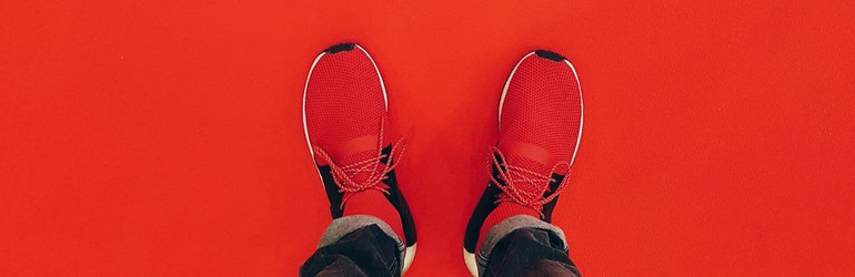 Red shoes on a red floor.