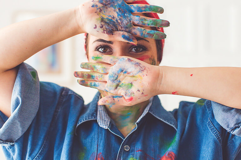 woman being creative with painting for self care