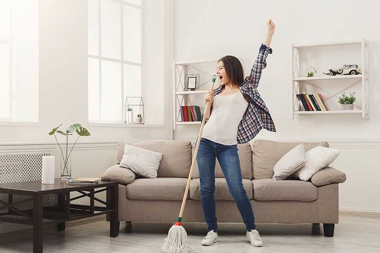joyful woman spring cleaning her house