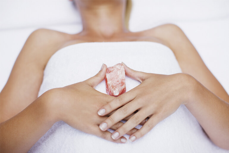woman holding rose quartz