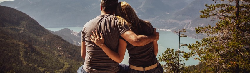 Two people hold each other and support each other at a time when they are sad.
