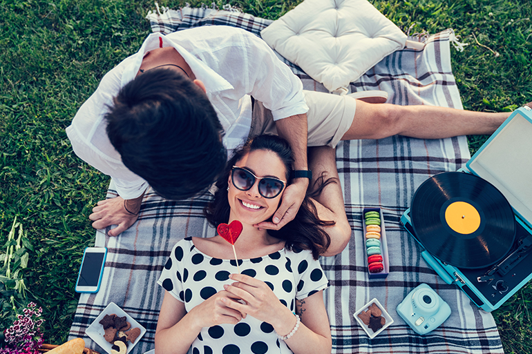 boyfriend and girlfriend having a picnic