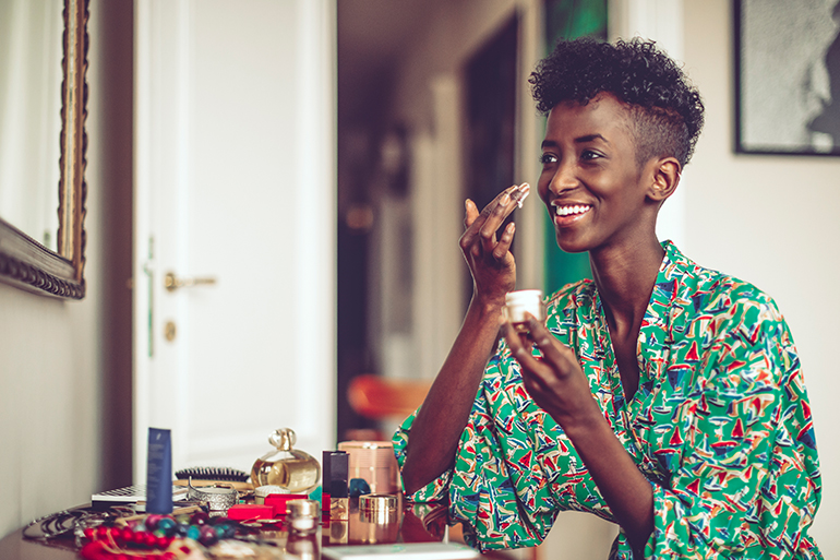woman using beauty products