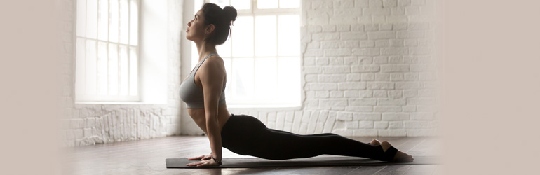 A person doing the upward facing dog pose.
