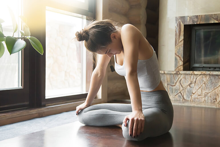 woman doing a bandha while meditating