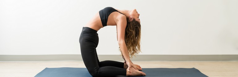 woman in camel pose
