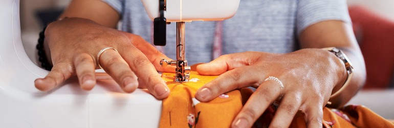 woman sewing a garment at home